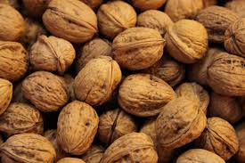 Walnuts have a crinkled brown shell with nuts inside.  Discover benefits of walnuts for the body, skin and hair. Storing tips and walnut recipes!